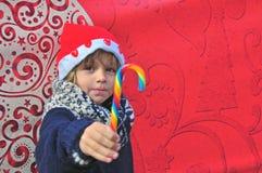 Rozochocona chłopiec z cukierkiem Fotografia Royalty Free