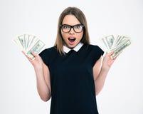 Rozochocona kobieta trzyma dolarowego rachunek Zdjęcia Royalty Free