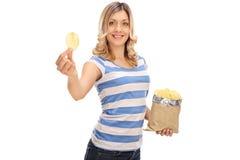 Rozochocona kobieta trzyma torbę układy scaleni fotografia stock