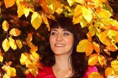 Rozochocona kobieta w jesień parku Obraz Royalty Free