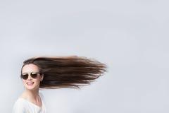 Rozochocona kobieta z włosy w wiatrze Zdjęcie Royalty Free