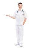 Rozochocona męska pielęgniarka pokazuje produkt Obrazy Royalty Free