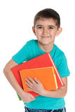 Rozochocona młoda chłopiec z książkami zdjęcie royalty free
