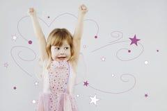 Rozochocona mała dziewczynka z magicznym kijem Obrazy Stock
