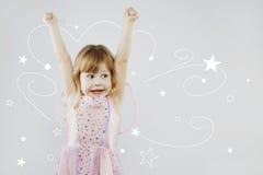 Rozochocona mała dziewczynka z magicznym kijem Obrazy Royalty Free