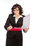 Rozochocona starsza biznesowa kobieta z falcówką zdjęcie stock