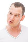 Rozochocona twarz z grymasu młodym człowiekiem Zdjęcie Stock