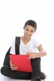 Rozochocone nastoletniego chłopaka writing notatki zdjęcie royalty free