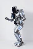 Rozochoconego robota dancingowy dżin biały tło Obraz Royalty Free