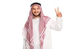 Rozochocony arab robi pokój ręki gestowi Obrazy Stock