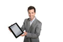 Rozochocony biznesmen przedstawia grafikę na pastylce lub tekst Obraz Stock