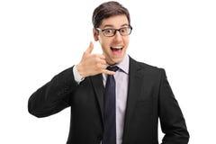 Rozochocony biznesmen robi wezwaniu ja gest Zdjęcia Stock