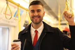 Rozochocony biznesmen używa jawnego transport fotografia royalty free