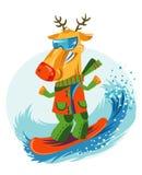 Rozochocony Bożenarodzeniowy reniferowy jazda na snowboardzie obraz stock