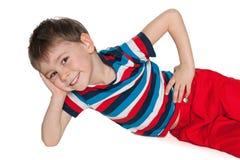 Rozochocony chłopiec odpoczywać obrazy royalty free