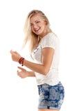 Rozochocony dancingowej dziewczyny doskakiwanie krótki na białego tła latającym włosy Fotografia Stock