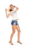 Rozochocony dancingowej dziewczyny doskakiwanie krótki na białego tła latającym włosy Obraz Royalty Free
