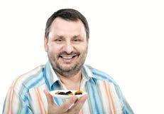 Rozochocony facet lubi wysuszone owoc Obraz Royalty Free