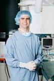Rozochocony Męski chirurg Z rękami Spinać Obrazy Stock