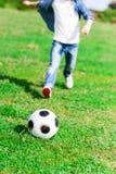 Rozochocony męski dziecko bawić się futbol Obraz Royalty Free