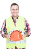 Rozochocony męski konstruktora mienia hełm i rękawiczki Fotografia Royalty Free