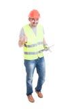 Rozochocony męski budowniczy z pastylka kciukiem up Zdjęcie Stock