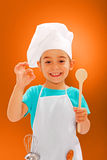 Rozochocony mały szef kuchni pokazuje dobrego smak Zdjęcia Stock