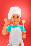 Rozochocony mały szef kuchni pokazuje dobrego smak Zdjęcie Stock