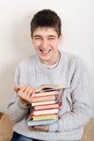 Rozochocony nastolatek z książki Zdjęcia Stock