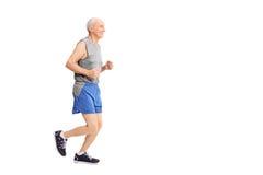 Rozochocony starszy jogging w sportswear obraz royalty free