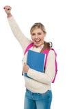 Rozochocony student uniwersytetu podnosi jej rękę Fotografia Royalty Free