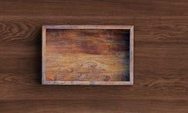 Rozpieczętowany kwadratowy drewniany pudełko na drewnianym stole ?wiadczenia 3 d royalty ilustracja