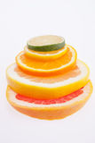 Rozsypisko kolorowe plasterka cytrusa owoc zamyka up Obrazy Royalty Free