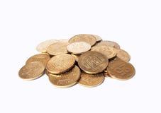 Rozsypisko monety na białym tle Obraz Royalty Free