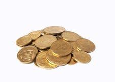 Rozsypisko monety na białym tle Zdjęcia Royalty Free