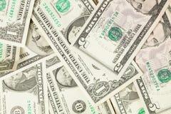 Rozsypisko my dolary, pieniądze gotówkowy tło zdjęcie royalty free