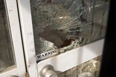 roztrzaskujący okno Fotografia Royalty Free