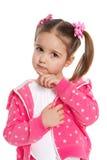 Rozważna preschool dziewczyna w menchiach obraz stock