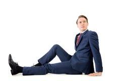Rozważny biznesmen patrzeje daleko od na podłoga Fotografia Royalty Free