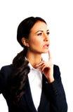 Rozważny bizneswoman z palcem pod podbródkiem Fotografia Royalty Free
