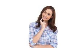 Rozważna kobieta umieszcza jej palec na jej podbródku Zdjęcia Royalty Free