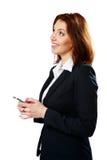 Rozważny bizneswomanu mienia smartphone Fotografia Stock