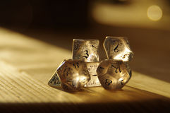 RPG dice for Dungeons and Dragons. Few transparent rpg dice on table highlighted by the sun. D&D - Dungeons and dragons Stock Photo