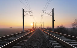 Rrailroad at a sunset Stock Photos