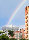 Rrainbow over highrises Royalty Free Stock Images