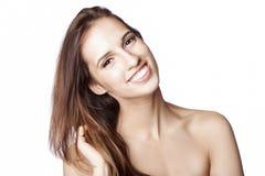 Rörande hår för lycklig kvinna Royaltyfria Bilder