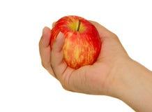 Rred Apple in der Hand lizenzfreie stockfotografie