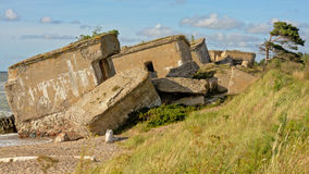 Remains of bombed sovjet bunkers on the coast of the Baltic sea at Karosta. Rremains of destroyed sovjet bunkers on the beach of the Baltic sea, part of a fort Royalty Free Stock Photography