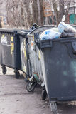 Rrey dumpster, recycle, waste and garbage bins near building. Ba Stock Images