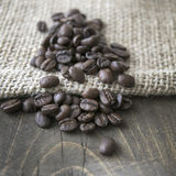 Rroasted coffee beans on a burlap sack Royalty Free Stock Image